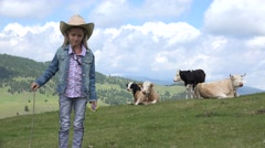 4K Portrait of Cowboy Girl Looking to Camera, Farmer Child Lead Cows to Pasture Stock Footage