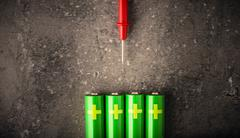 AA batteries and cable for measure of power and energy level Stock Photos
