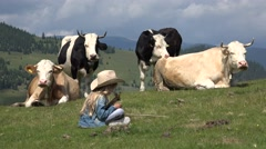 4K Cowherd Child Pasturing Cows, Farmer Girl Smelling Flowers on Grass Meadow Stock Footage