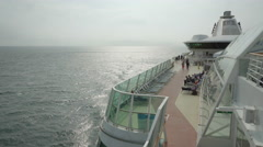 Cruise ship sailing at sea - open deck and starboard side view Stock Footage