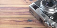 Retro vintage camera on wood table background. Space for text. Stock Illustration