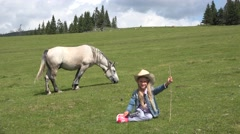 4K Portrait of Farmer Cowboy Child Pasturing Horse, Smiling Girl Playing Outdoor Stock Footage