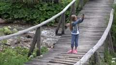 4K Tourist Girl Playing Tablet Taking Selfie, Child on Mountains Trail in Camp Stock Footage