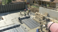 Master shot of concreting building construction with group of workers by Sheyno. Stock Footage