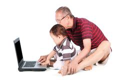 Baby learn how to use a laptop Stock Photos