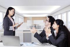 Business partners giving applause Stock Photos