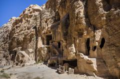 Cave tombs in Nabataean city of the Siq al-Barid in Jordan. It is known as th Stock Photos