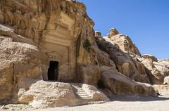 Cave tomb in Nabataean city of the Siq al-Barid in Jordan. It is known as the Stock Photos