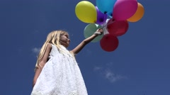 4K Girl Playing with Balloons Looking at Blue Sky, Happy Child Birthday Outdoor Stock Footage