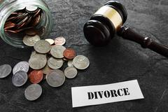 Divorce message with coins and gavel Stock Photos