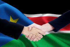 Negotiation handshake with flag of South Sudan Stock Photos