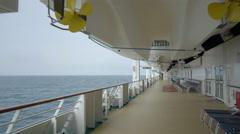 Cruise ship sailing at sea - walking board tracking shot Stock Footage