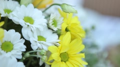 Bouquet of flowers and a salad on the table. Dynamic change of focus Stock Footage
