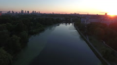 Flying Over River at Sunset Towards Warsaw Poland Skyline Stock Footage