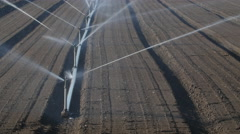 Line of sprinklers irrigate soil. Closeup. Beaverton, Ontario, Canada. Stock Footage