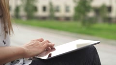Women's hands with the black tablet. Uncertain woman uses touchscreen Stock Footage