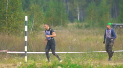 Sportsmen run between stages at the Race of Heroes Stock Footage