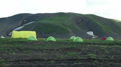 Camping and tents in caldera of volcano. Kamchatka. Dolly like. Stock Footage