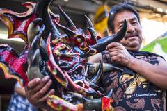 Craftsman shows his diabolical mask Stock Photos