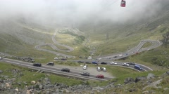 4K Aerial Traffic on Transfagarasan Roads in Romania, Mountains View Foggy Day Stock Footage