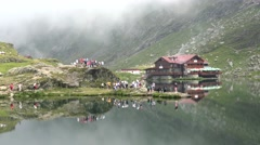 4K Timelapse People Visiting Balea Glacial Lake, Lac in Transfagarasan, Romania  Stock Footage