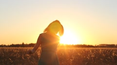 Attractive girl enjoy nature running, jumping, dancing in fields on sunset. Stock Footage