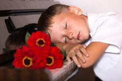 Pianist boy with a bouquet of flowers Stock Photos