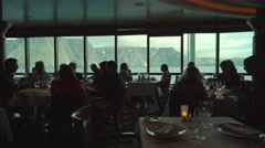 Sea view from a cruise ship restaurant - silhouettes in the foreground Stock Footage