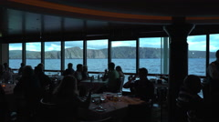 Amazing sea view from a cruise ship restaurant - silhouettes in the foreground Stock Footage