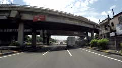 Moving Vehicle shot passing under overpass free way Stock Footage