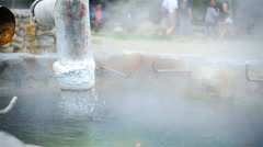 Slow motion of the Hot Springs flowing out of the pipe with steam Stock Footage