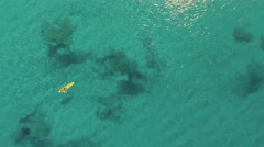 Aerial, Kayak boat crossing a turquoise water Stock Footage