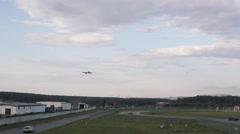 White Passenger Plane is Landing on Airstrip Stock Footage