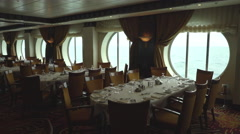 Laid tables in a elegant and stylish restaurant - dining room in the cruise ship Stock Footage