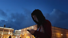 Young Girl Writes in the Messenger on Mobile Phone on Background of the Night Stock Footage