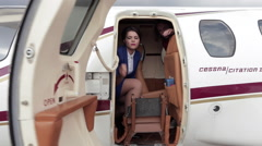 Flight Attendant Closes the Door of the Private Business Jet Stock Footage