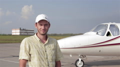 Pilot of a Private Plane Stands on Airfield Next to the Jet Stock Footage