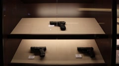 Handguns on display Stock Footage