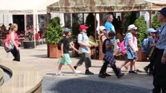 Children walking in line through town Stock Footage