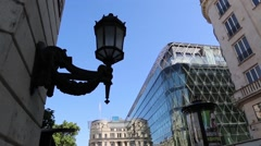 Tilting down from lamp post on side of building to inner city of budapest Stock Footage