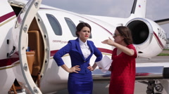 Girl Gives Guidance Training to the Flight Attendant of Private Jet Stock Footage