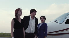 Three Smiling People Standing on Airfield Stock Footage