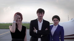 Businessman With Partner Girl and a Flight Attendant Standing at the Airport Stock Footage