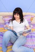 Beautiful young woman reading Stock Photos