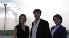Two Girls and Man Standing on the Airfield Stock Footage