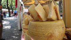 Blocks of cheese displayed for sale in street market Stock Footage