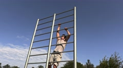Young athlete on gymnastic bars Stock Footage