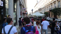 Following group of people walking through city streets Stock Footage