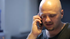 Young man is talking on cell phone in photo studio Stock Footage