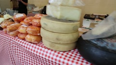 Various cheeses displayed for sale on table Stock Footage